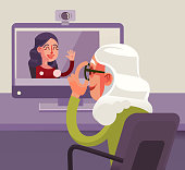 Happy smiling grandmother character talking to her granddaughter by Internet