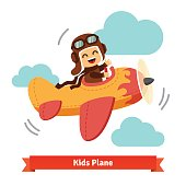 Happy smiling kid flying plane like a real pilot