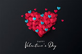 Happy Valentine's Day banner. Holiday background design with big heart made of pink, red and blue Origami Hearts on black fabric background