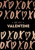 Happy Valentine's day greeting card with rose gold lettering. Phrase XOXO (hugs and kisses) with hearts. Modern design for card or invitation.