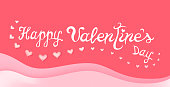 Happy Valentines Day. Text in hand drawn style and hearts on pink background.