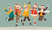 Happy winter vacation. Warmly dressed people in the jump.