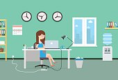 Happy woman working with laptop. Office interior and workplace.