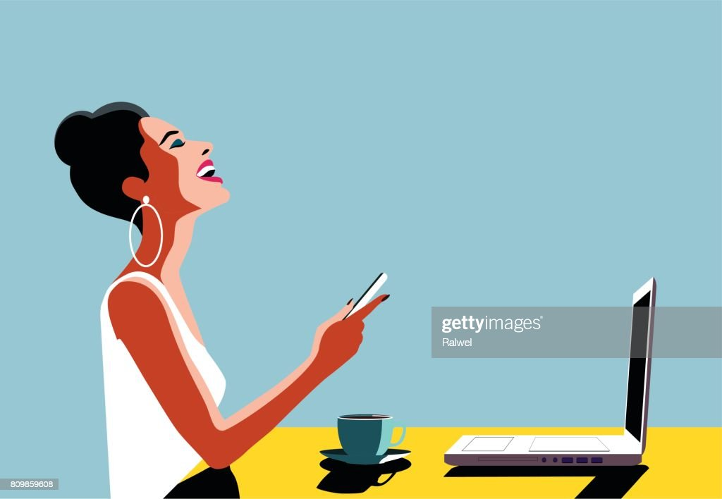 Happy Young Beautiful Woman Using Smartphone and Laptop