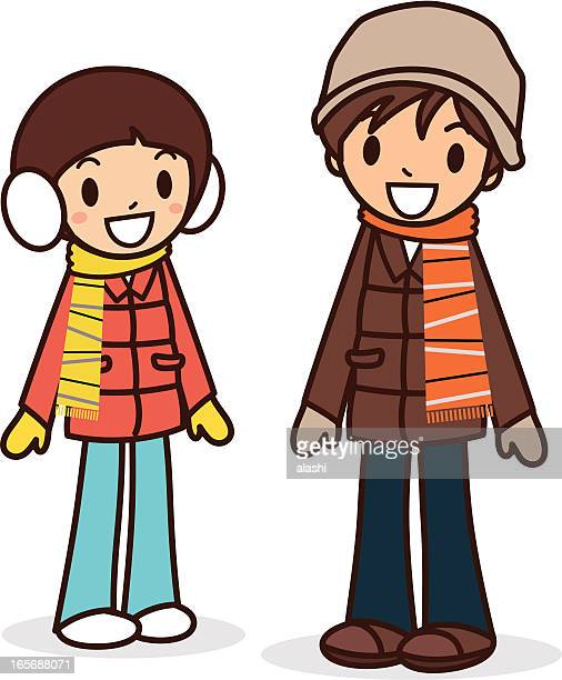 Happy young boy and girl in winter clothes
