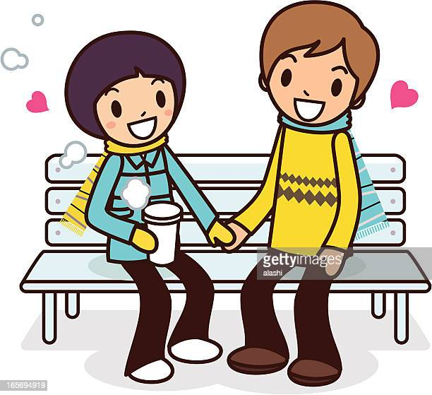 Happy young couple sitting on bench