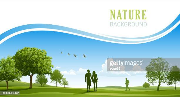 happy young couple walking in the spring park - cloudscape stock illustrations, clip art, cartoons, & icons