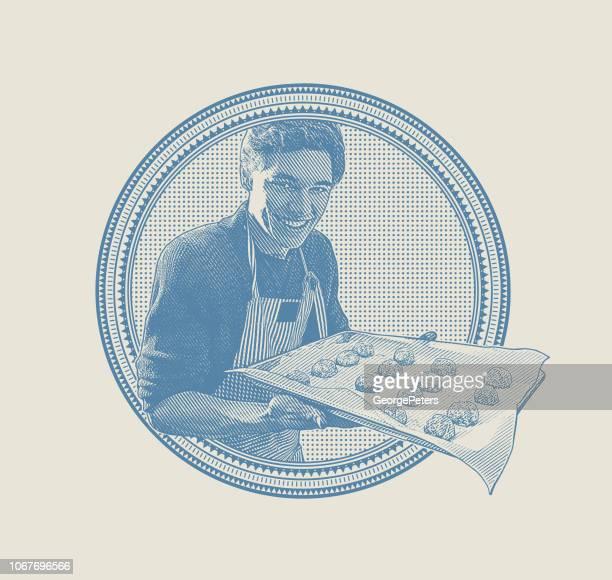 Happy Young man baking cookies