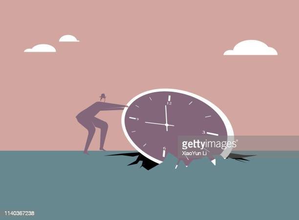 Harvesting—Businessman pulls out the clock from geography.