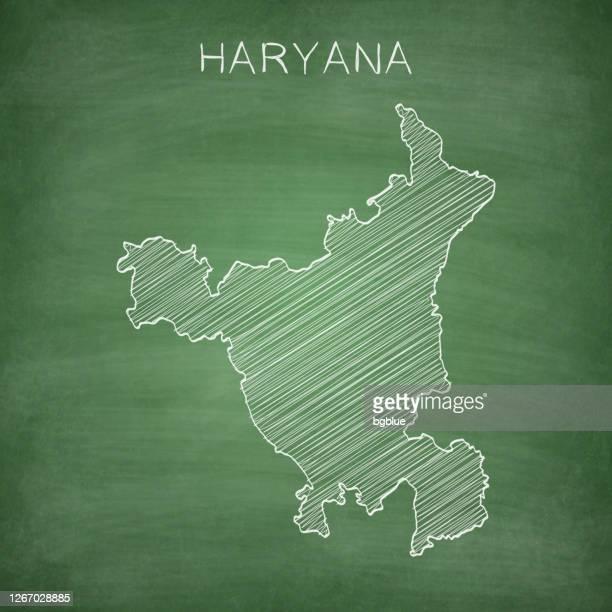 haryana map drawn on chalkboard - blackboard - haryana stock illustrations