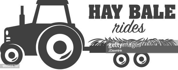 hay bale rides icon design - tractor stock illustrations