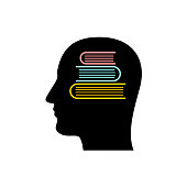 Head silhouette with stack of books inside.