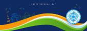 Header or banner design with National waving flag with Ashok Wheel and famous Indian monuments on blue background.