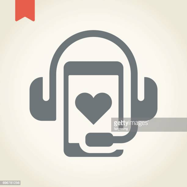 Headphone with smart phone on heart icon