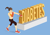 Healthy woman breaking the word Diabetes with punching.