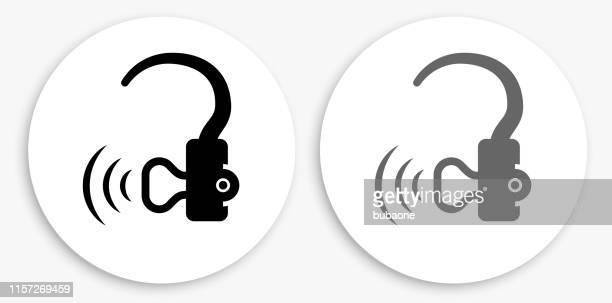 hearing aid black and white round icon - hearing aid stock illustrations, clip art, cartoons, & icons