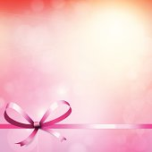 Heart blur bokeh lights background with ribbon