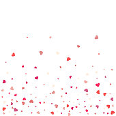 Heart confetti of Valentines petals falling on white  background. Flower petal in shape of heart confetti for Women's Day