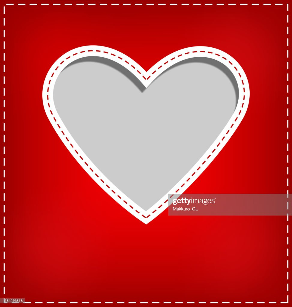 Heart cutout in red card on grey