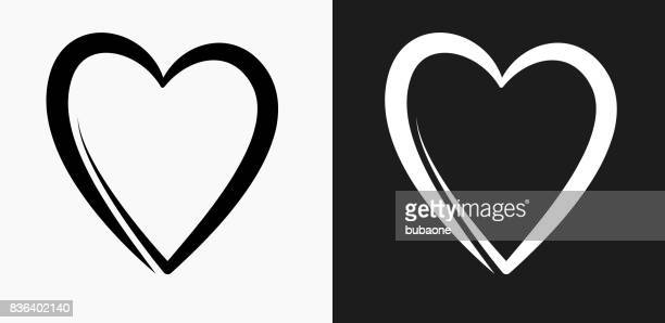 heart icon on black and white vector backgrounds - heart shape stock illustrations