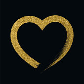 Heart icon with glitter effect, isolated on black background.