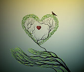 heart of nature, treelike hand hold green heart, protect forest concept,