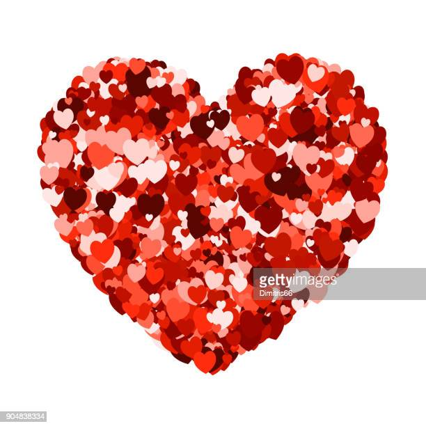 Heart shape made from red heart shaped confetti on white background.