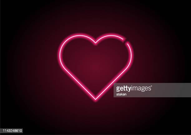 heart shape red neon light on black wall - heart shape stock illustrations