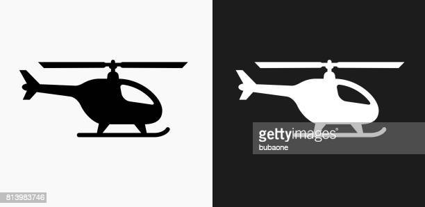 helicopter icon on black and white vector backgrounds - helicopter stock illustrations