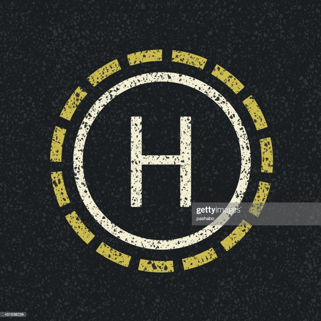 Helicopter landing pad on black pavement
