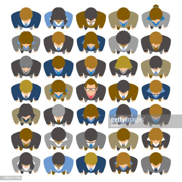 high angle view of businessman looking up and standing in large group of business people - new hire stock illustrations