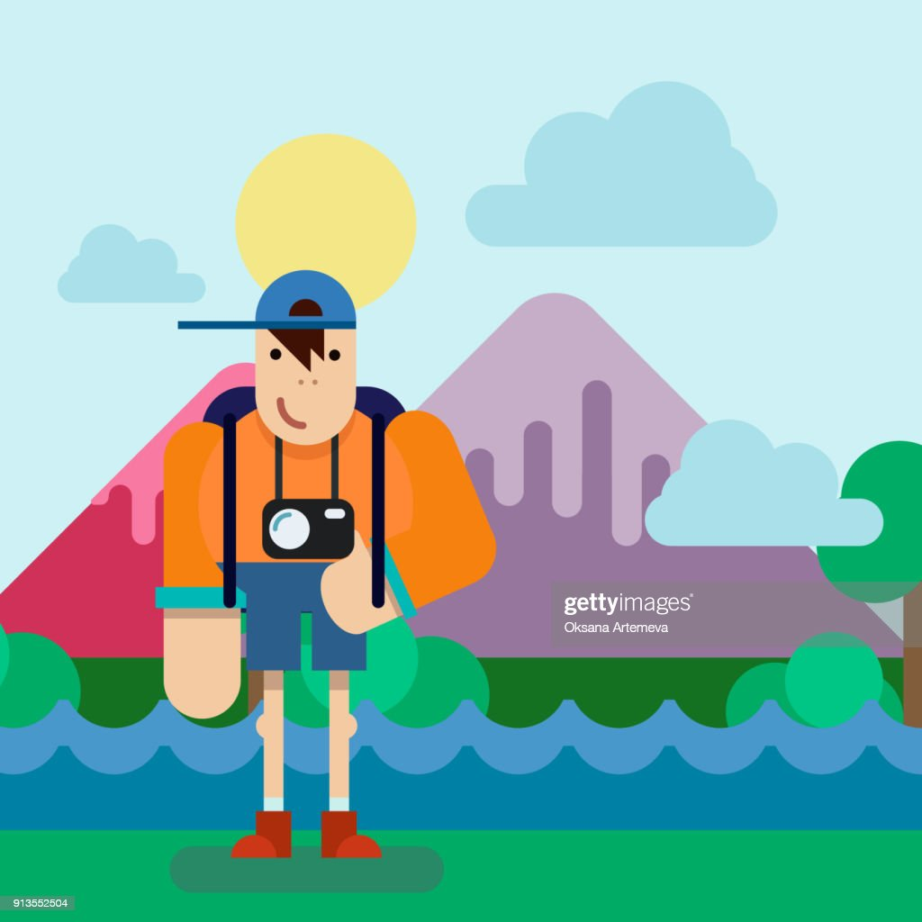 Hiking tourist man with Camera. Mountains background.