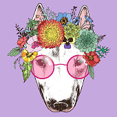 Hippie bull terrier in the floral wreath and round sunglasses.