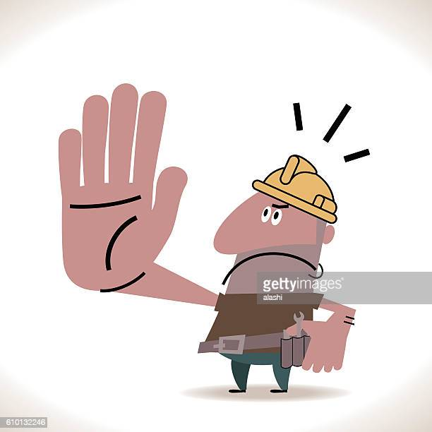 Hispanic Construction Worker Showing Stop Hand Sign