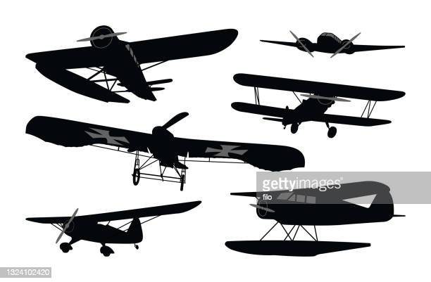 historical aircraft and antique flying planes - wwi plane stock illustrations