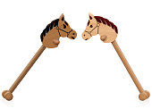 Hobby horse fight. Symbol for problem children, educational conflict management, social interaction or aggressive childlike behavior - isolated vector illustration on white background.