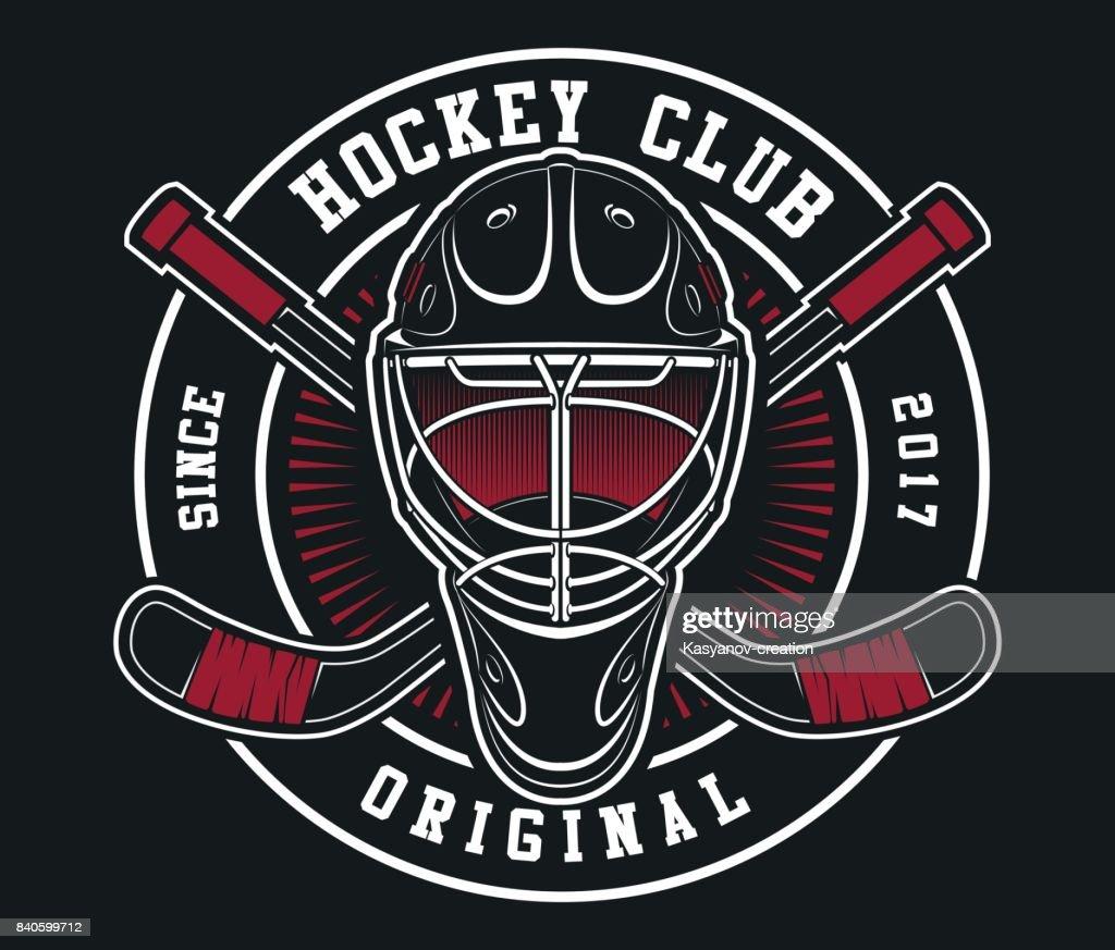 Hockey helmet with sticks emblem