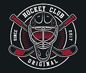 Hockey helmet with sticks emblem