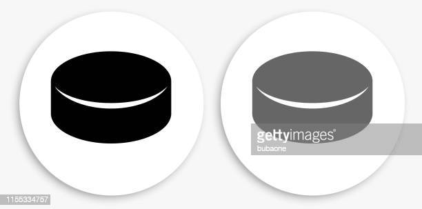 hockey puck black and white round icon - puck stock illustrations
