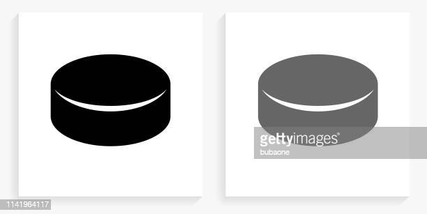 hockey puck black and white square icon - puck stock illustrations