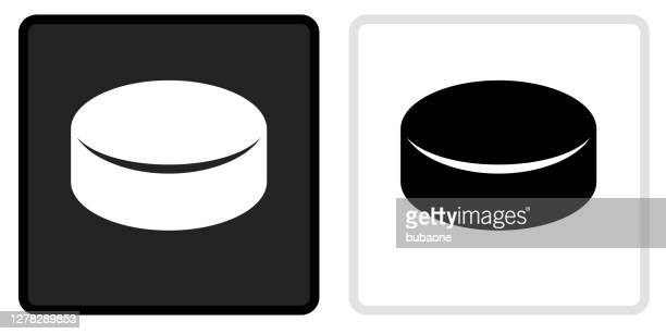 hockey puck icon on  black button with white rollover - puck stock illustrations