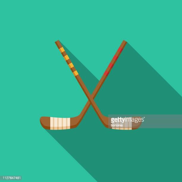 hockey sticks winter sports icon - hockey stick stock illustrations
