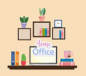 home office interior laptop teacup books