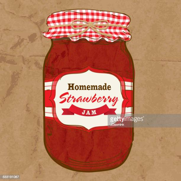 Homemade strawberry jam mason jar with checkered top