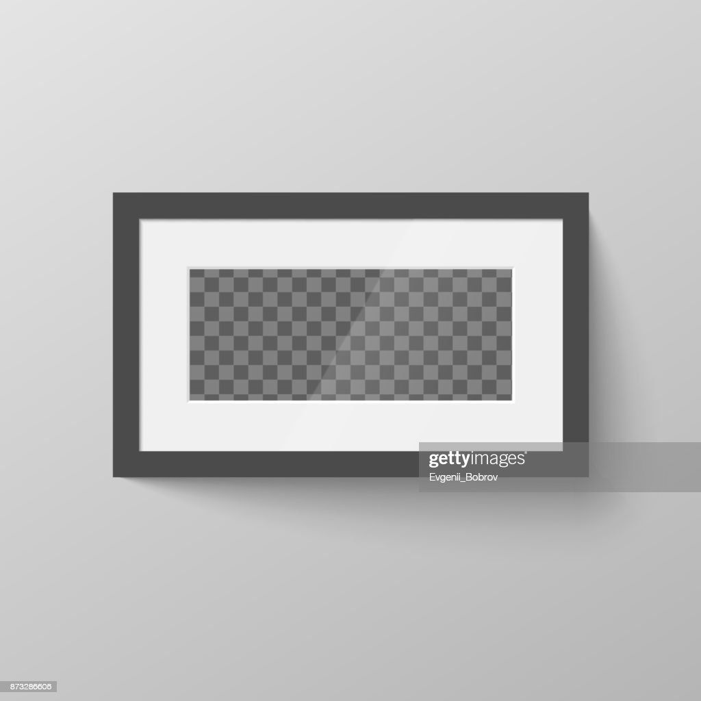 Horizontal black blank picture frame with transparent place for photo on gray wall