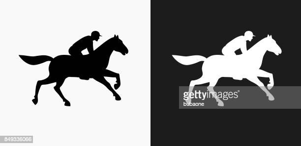 horse racer icon on black and white vector backgrounds - horse racing stock illustrations