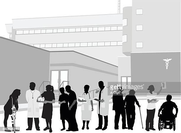 病院スタッフと患者