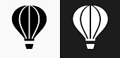 Hot Air Balloon Icon on Black and White Vector Backgrounds