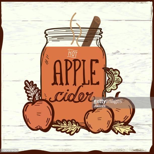 hot apple cider drink on wooden texture - cider stock illustrations