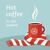 Hot coffee in red cup.Cup of coffee swathed in scarf.